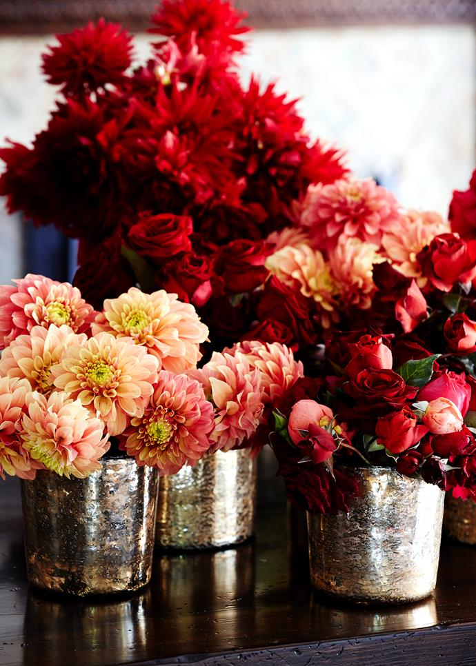 Gorgeous blooms in metallic vases bring colour and life to the stately home's interior.