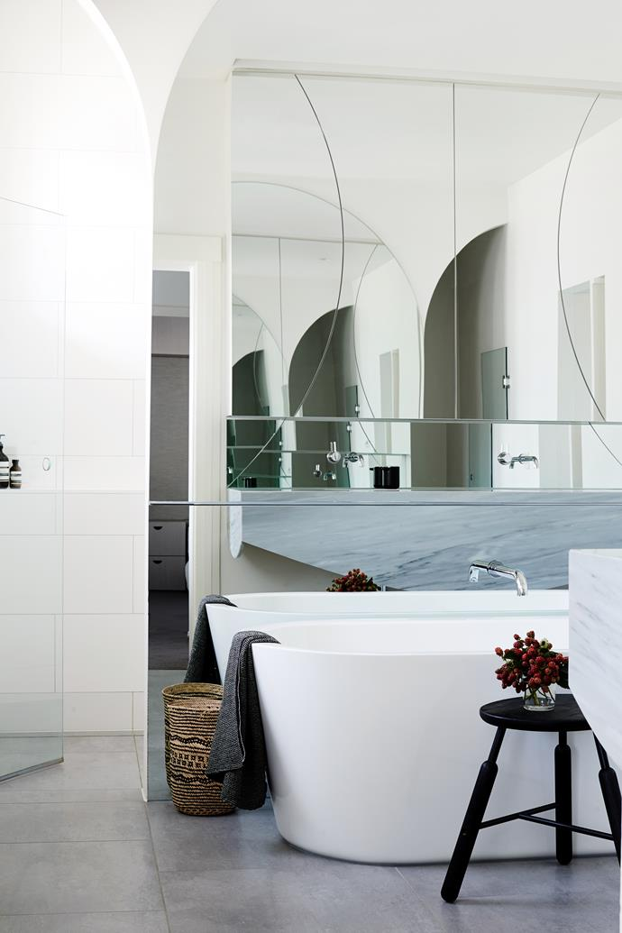 """In the main bathroom, arcs in the mirror create interesting reflections. Inovita Solo bath, Norm Raft NA3 **stool** from [Great Dane Furniture](http://www.greatdanefurniture.com/?utm_campaign=supplier/