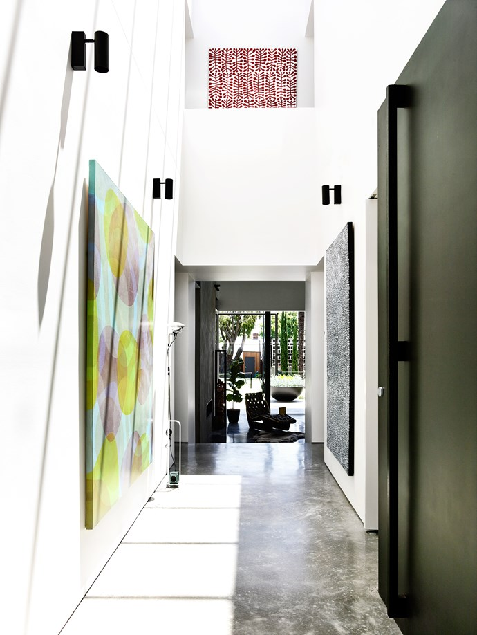 """Moving further into the space, there's a moment of mystery before you step down into the expansive living zone. """"The house was designed to reveal itself sequentially, unfolding through a progression of spaces that combine both compactness and expansiveness,"""" says Matt."""