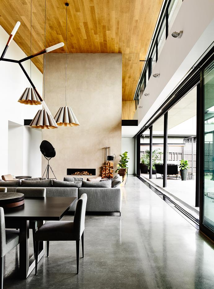 """The ground floor features a towering timber-clad ceiling, a 16-metre-long wall of floor-to-ceiling glass and seamless extension to the outdoor deck.   **Dining table** and **chairs** by [Sacha Design](http://www.theloop.com.au/sachadesign/portfolio/?utm_campaign=supplier/