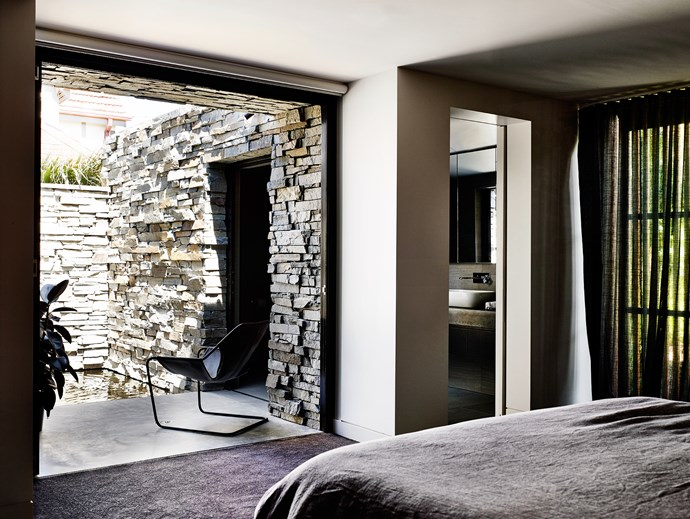 """The master bedroom opens to a stacked slate courtyard with a pond. Objekto Paulistano **chair** from [Hub](http://www.hubfurniture.com.au/?utm_campaign=supplier/