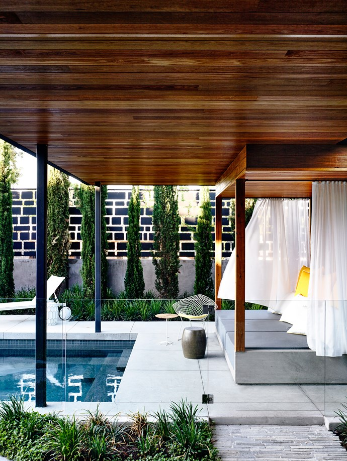"""A cabana overlooks the backyard pool. Bertoia Diamond **chair** by [Knoll](http://www.knoll.com/