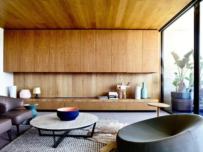 """Timber wraps the wall unit and continues across the ceiling of the upstairs sitting space. From here, there is access to a balcony dotted with potted agave. Succulents and ficus are used indoors, too, hinting at """"warm climate modernism and mixing with an eclectic assemblage of objects and new, contemporary pieces"""", says Matt. **Coffee table** from [Camerich](http://www.camerich.com.au/?utm_campaign=supplier/