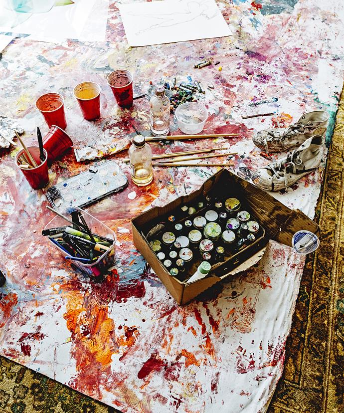 """A canvas sheet protects the wooden floor from splashes and drips while Vicki creates. """"I still manage to make a mess though, and find bits of paint all around the house,"""" she says."""