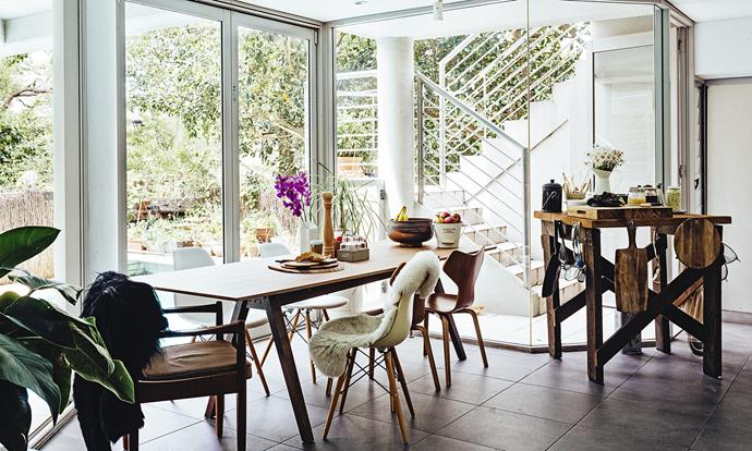 The open-plan dining area looks out over the sparkling swimming pool, and is the perfect place to entertain morning, noon or night.