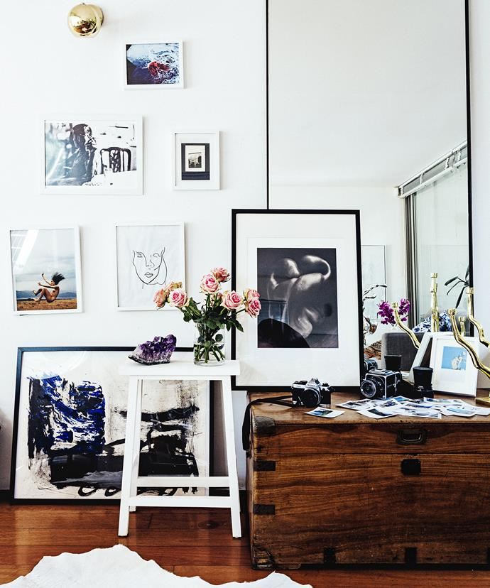 """A collection of artworks and photographs were used to fill an empty wall in the [home of two Sydney-based artists](http://www.homestolove.com.au/gallery-artists-in-residence-2429/?utm_campaign=supplier/
