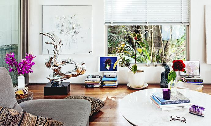 """Pride of place in the main living area is a silver sculpture Vicki and Ted bought from a gallery in Hong Kong. """"The main living area gets the afternoon sun, so we often have friends over for sundowner spritzers,"""" Vicki says. """"We call it 'The Middle Bar' as a joke."""""""