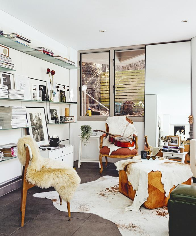 With warming cowhides, soft sheepskins and walls lined with photographs and fashion mags, the living area on the ground floor is a comfortable chill-out zone.