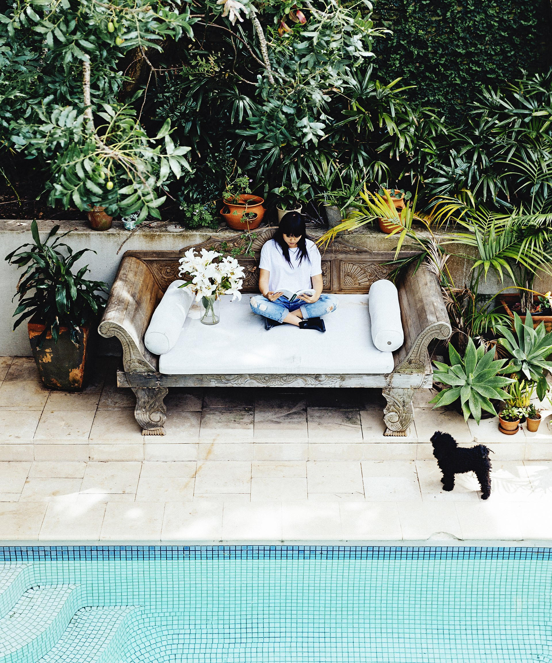 "This oversized stone bench by the pool is the perfect place to relax, whether you're wrapped up in a book or in a towel after a morning swim. [Take a full tour of artist Vicki Lee's light filled home here](http://www.homestolove.com.au/gallery-artists-in-residence-2429|target=""_blank"")."