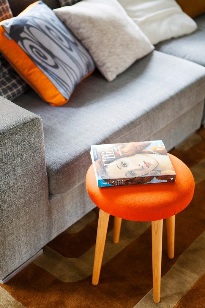 """Orange-trimmed **cushion** and Flow upholstered **stool** from [Southwood](http://www.southwoodhome.com.au/?utm_campaign=supplier/