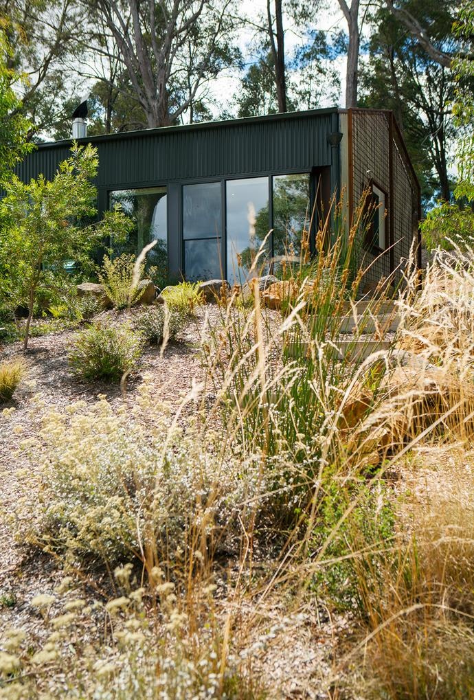 """The house, in essence a customised shed, is in tune with its surroundings. Boosting the home's green credentials are solar panels and rainwater tanks, and recycled materials were used wherever possible. Shed from [Totalspan](http://totalspan.com.au/?utm_campaign=supplier/