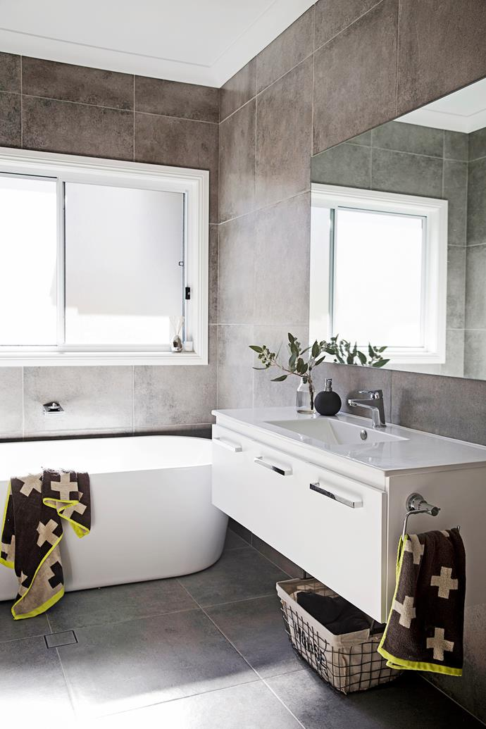 """The vanity in the main bathroom was custom-made by the builder. The freestanding bath, sink and taps are from [Reece](http://www.reece.com.au/?utm_campaign=supplier/