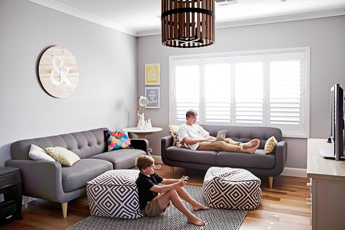 """The family room was designed as the go-to space to relax in after a long day. The Jumbo Ampersand wall clock is from [Target](http://www.target.com.au/?utm_campaign=supplier/
