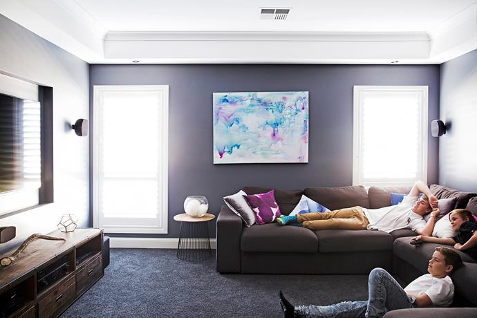 The media room has dark walls, to enhance TV viewing – much like a cinema.