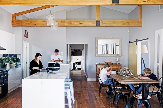 """The custom-made dining table has been paired with black metal and timber chairs from [Zanui](http://www.zanui.com.au/furniture/?utm_campaign=supplier/
