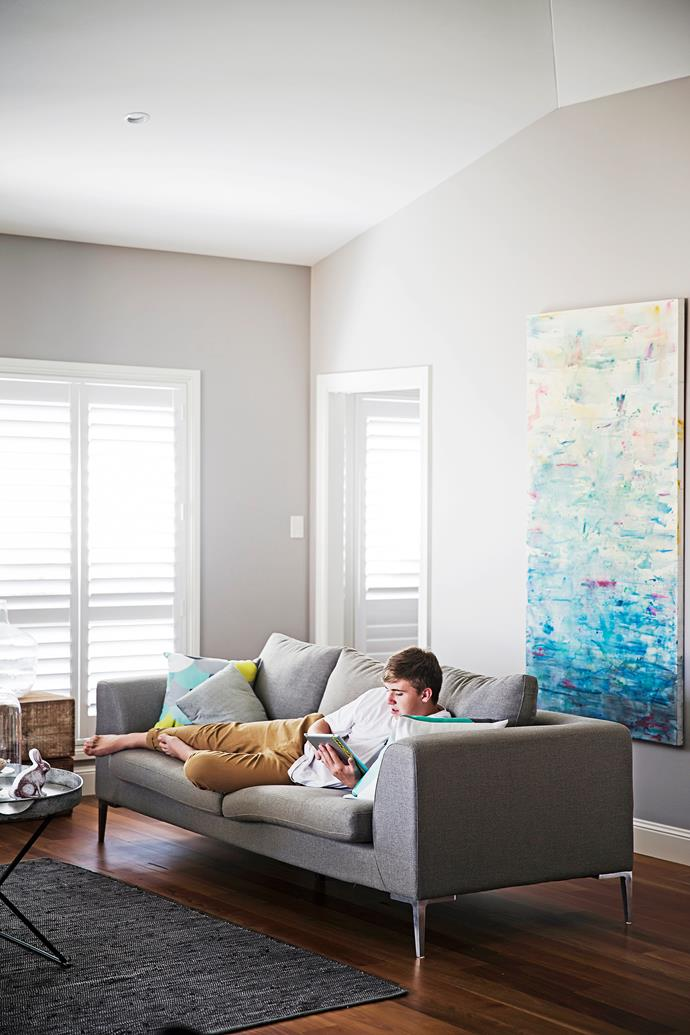 With a little help from the kids, Brooke painted the artwork above the sofa using watercolours.