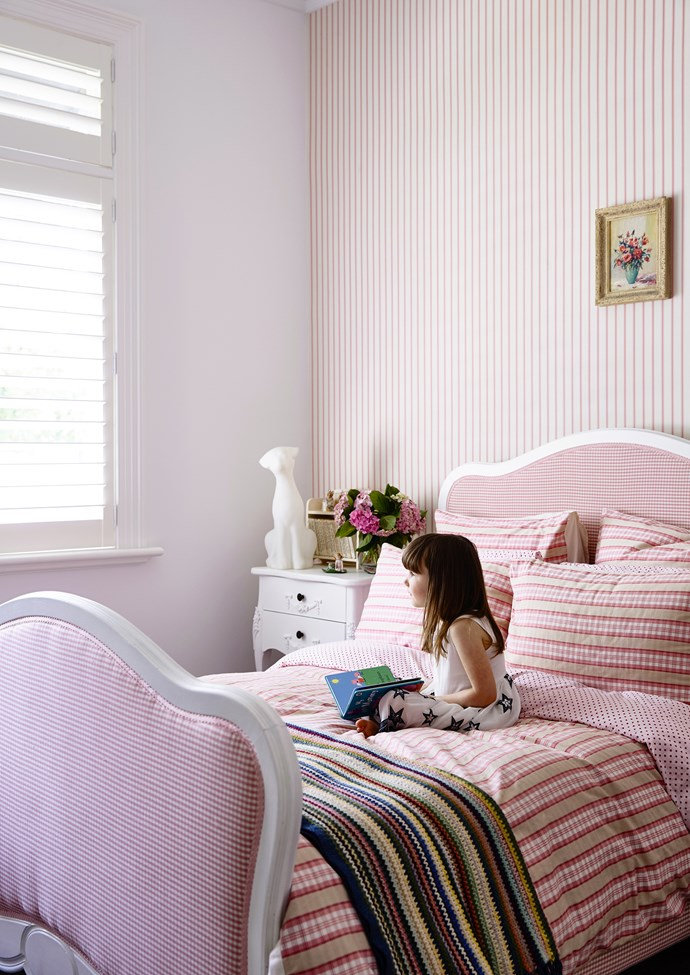 "Bridget's pretty-in-pink bedroom is furnished with her mother's childhood bed.   **Wallpaper** from [Wallpaper Direct](http://www.wallpaperdirect.com.au/?utm_campaign=supplier/|target=""_blank""). **Bedlinen** from [Adairs](https://www.adairs.com.au/?utm_campaign=supplier/