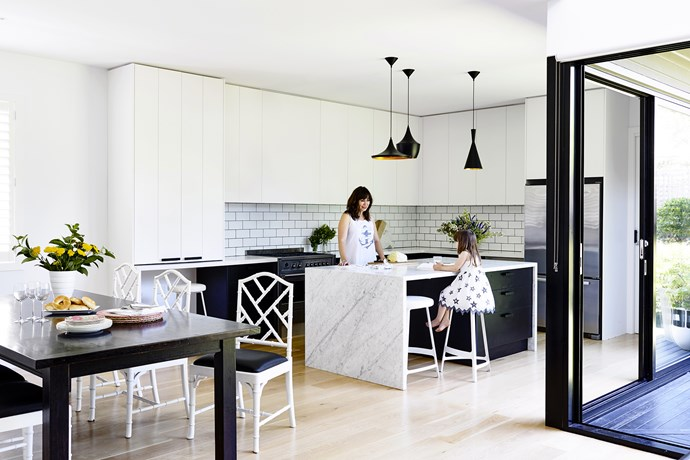 "A black and white palette keeps things fresh and elegant in the kitchen. The **benchtop** is Carrara marble from [European Marble](http://www.europeanmarble.com.au/|target=""_blank""). **Stools** and **pendant lights** from [Matt Blatt](http://www.mattblatt.com.au/?utm_campaign=supplier/