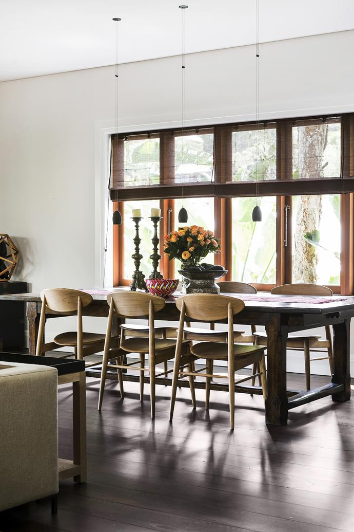 A mix of simple furniture and colourful ethnic wares creates an eye-catching tableau in the dining room.