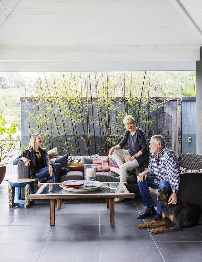 Meryl, her husband John, daughter Niccii and Rocky the Doberman. The family gravitates to this outdoor setting, imported from South Africa 24 years ago. John built the coffee table from an old wagon bed.