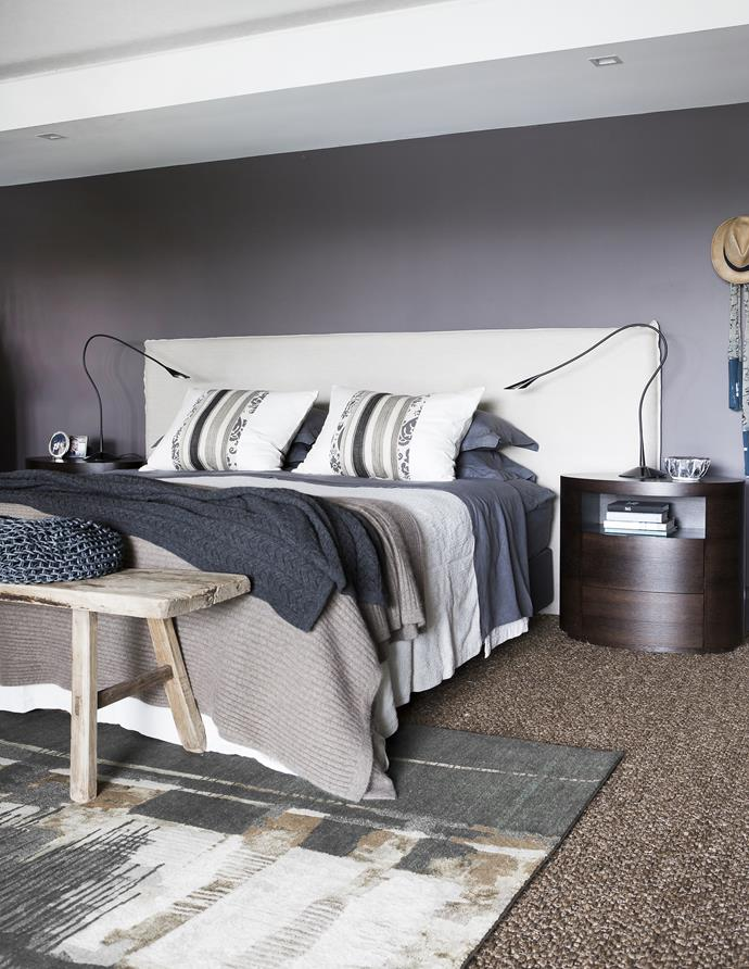 The main bedroom is a restful space with a soothing colour palette and a mix of textures.