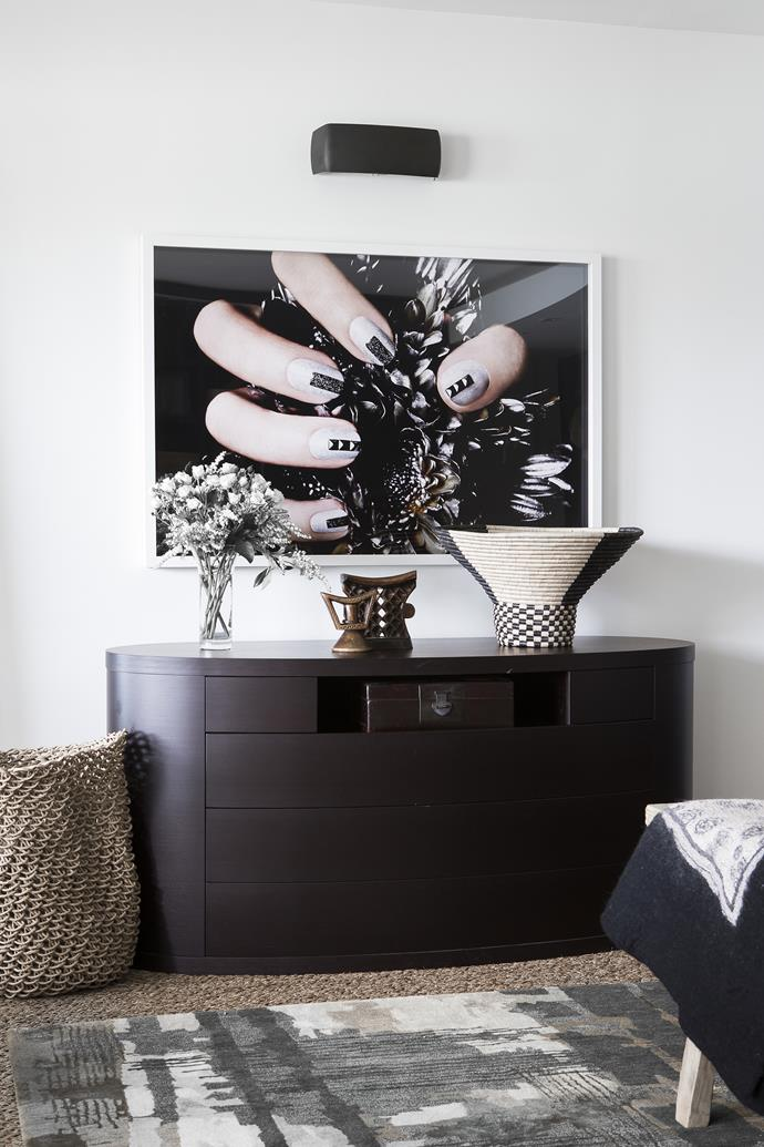Daughter Jenni may live in the UK, but she's close to the couple's hearts; the main bedroom features one of her bold photographic works.