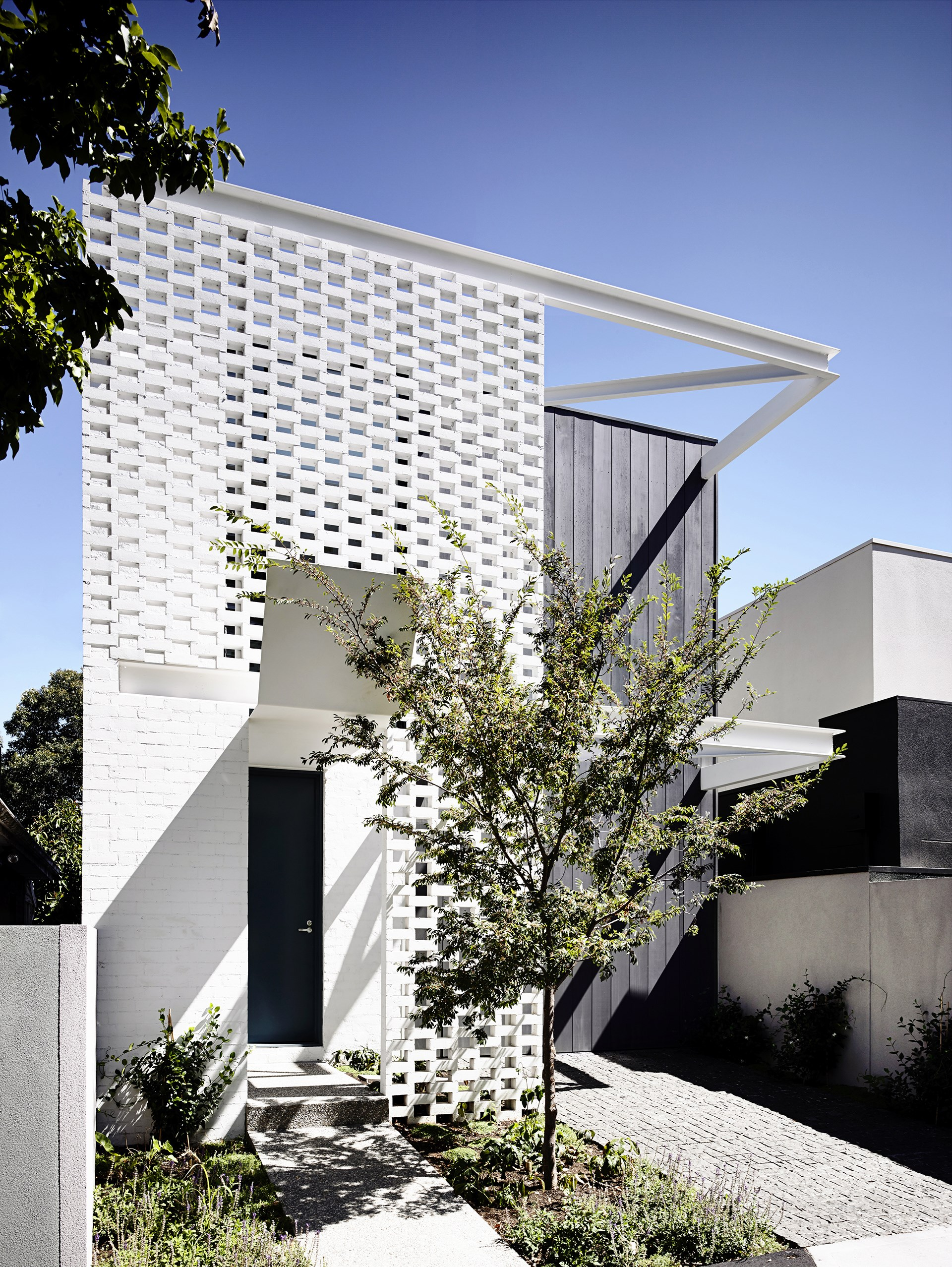 "The punctured brick screen at the front of this house creates depth: ""Its partial concealment hints at the home's inner workings, creating a feeling of mounting suspense,"" says architect Charlie Inglis of [Inglis Architects](http://inglisarchitects.com/). See more of this [luxury brick and steel architectural feat](http://www.homestolove.com.au/a-luxury-brick-and-steel-architectural-feat-2453). Photo: Derek Swalwell / *Belle*"