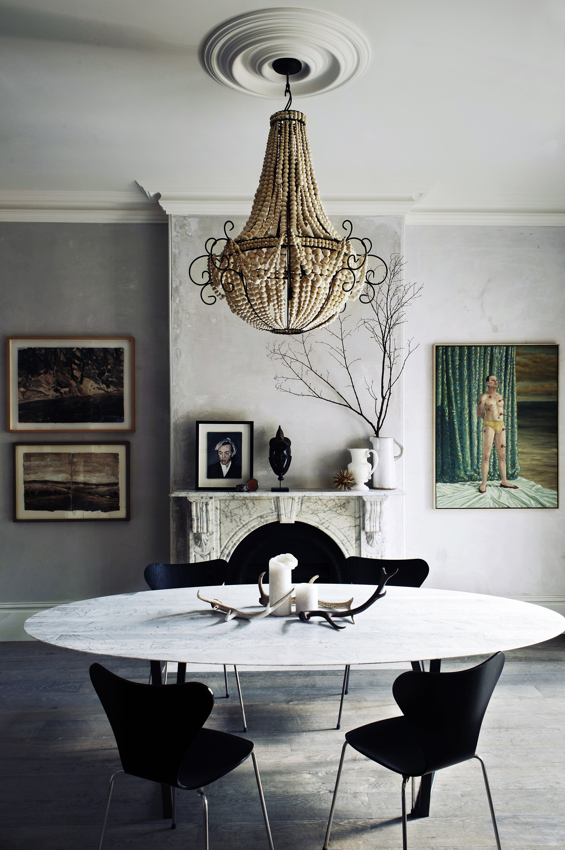 "Made from hundreds of clay beads, this delicate chandelier made to order from [The Design Hunter](http://www.thedesignhunter.com.au/?utm_campaign=supplier/|target=""_blank"") is a surprising addition to this otherwise subdued space. See more of this [moody Paddington home](http://www.homestolove.com.au/pennys-paddington-terrace-renovation-2462