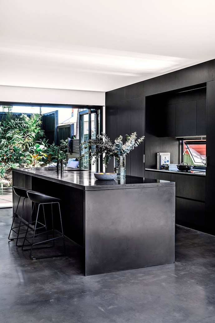 """In the kitchen, the concrete bench and flooring merge with [Polytec](http://www.polytec.com.au/?utm_campaign=supplier/