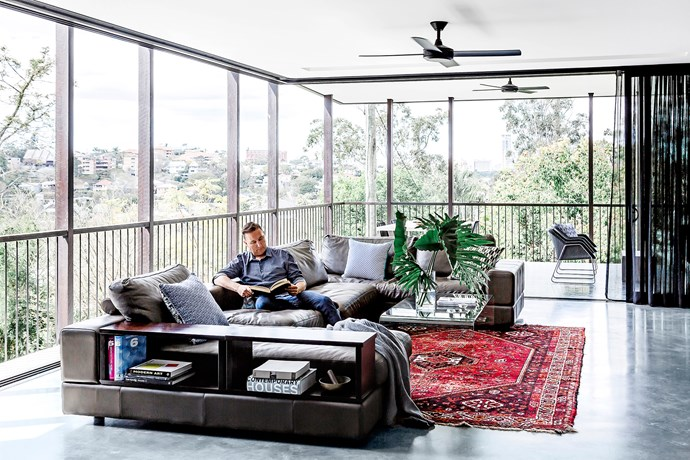 """On the main level, sliding glass doors move around freely, without columns to obstruct the outlook. """"It was pretty difficult to do,"""" says Mason, """"and was achieved by supporting the entire roof and upper level with columns placed on the outside of the building.""""  Jasper **sofa** and transparent **coffee table**, both from [King Living](http://www.kingliving.com.au/?utm_campaign=supplier/