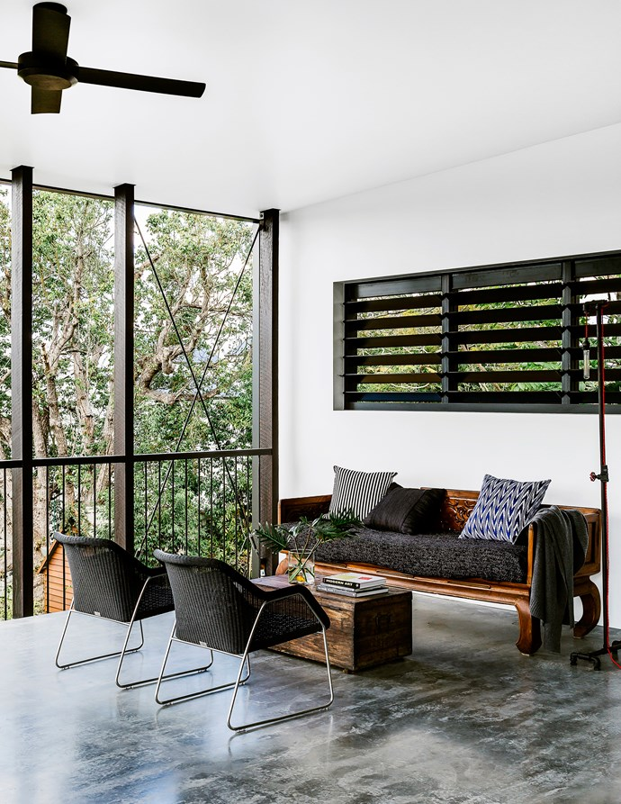 """One-of-a-kind objects on the rear deck include an antique icebox used as a coffee table and a timber sofa moved from the family's former home. Manutti Mood outdoor **chairs** from [Cosh Living](http://www.coshliving.com.au/?utm_campaign=supplier/