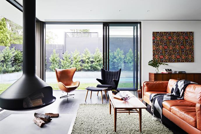 """The suspended rotating **fireplace** is one of the family's favourite features. A leather **sofa** from London store [Heal's](http://www.heals.co.uk/?utm_campaign=supplier/