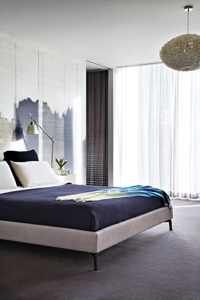 """A sliding door separates sleeping and dressing zones. **Bed**, [Meizai](http://www.meizai.com.au/?utm_campaign=supplier/