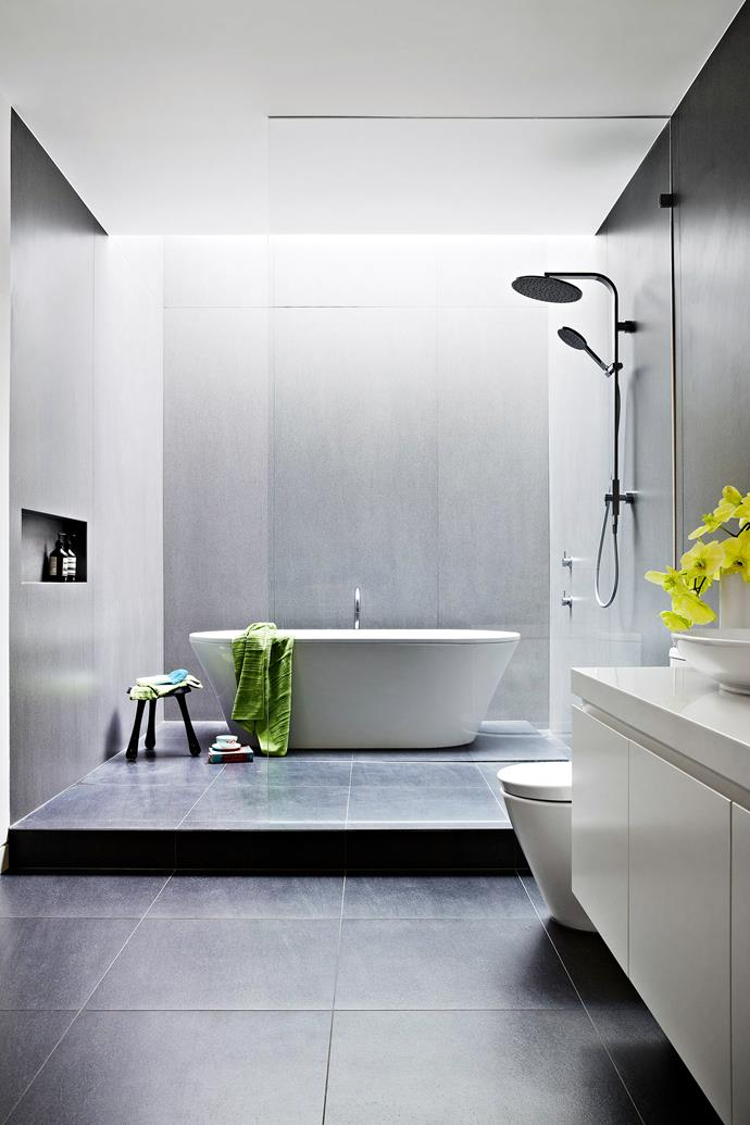 """A skylight directs dramatic lighting to this freestanding Kaldewai **bath** from Reece. **Towels**, [Safari Living](http://www.safariliving.com/?utm_campaign=supplier/