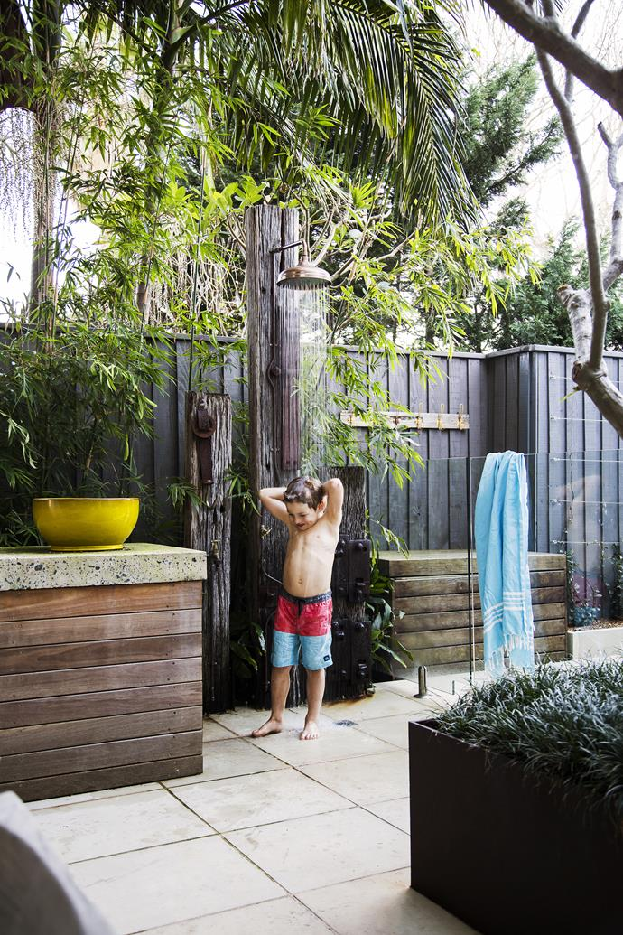 "An outdoor shower was added to the pool area, which comes in handy. ""In summer, we are at the beach nearly every day, and my husband wanted the kids to walk straight into the backyard, wash off the sand and jump into the pool,"" says the owner.  Photo: Maree Homer 