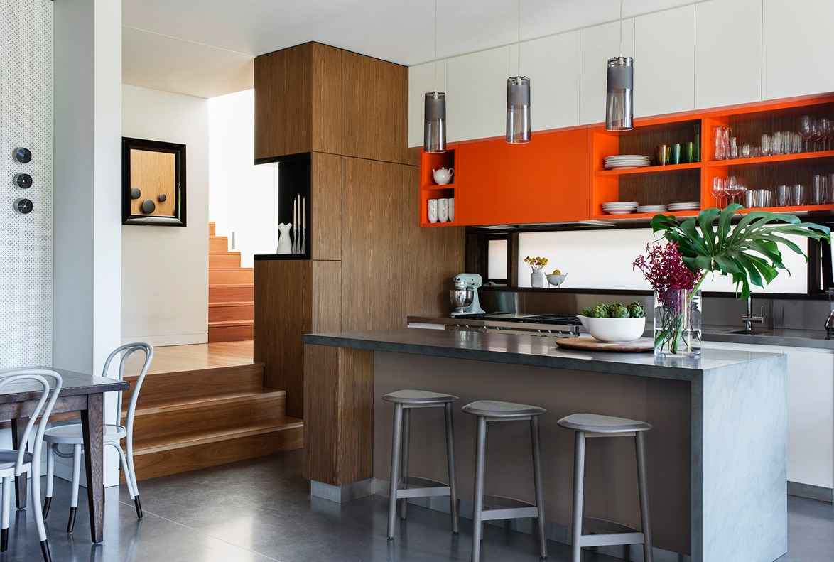"""A splash of zesty orange delivers an element of fun and energy in this [highly-functional cook's kitchen](http://www.homestolove.com.au/kitchen-renovation-colour-pop-2483 target=""""_blank"""")."""