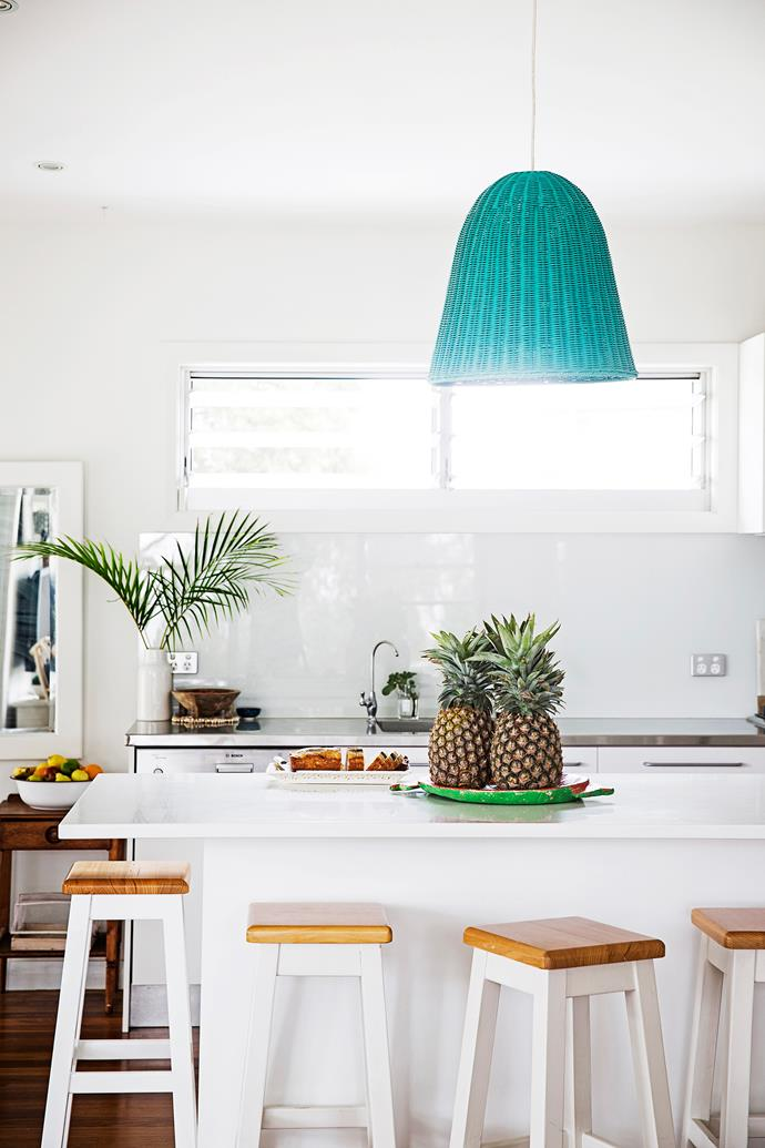 "The blue **pendant** light, bought online at [The Family Love Tree](https://thefamilylovetree.com.au//?utm_campaign=supplier/|target=""_blank"") stands out against the crisp white kitchen."