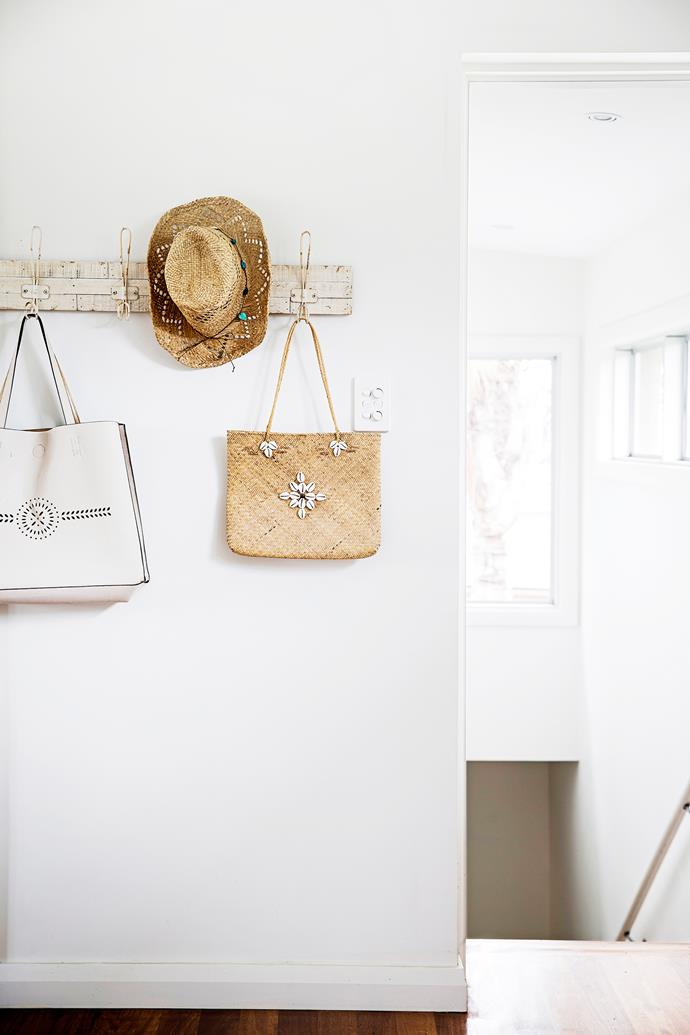 "Bags and a beach hat are displayed on rustic **coat hooks** from [Rust](http://www.rustonline.com.au/?utm_campaign=supplier/|target=""_blank"") in Avalon."