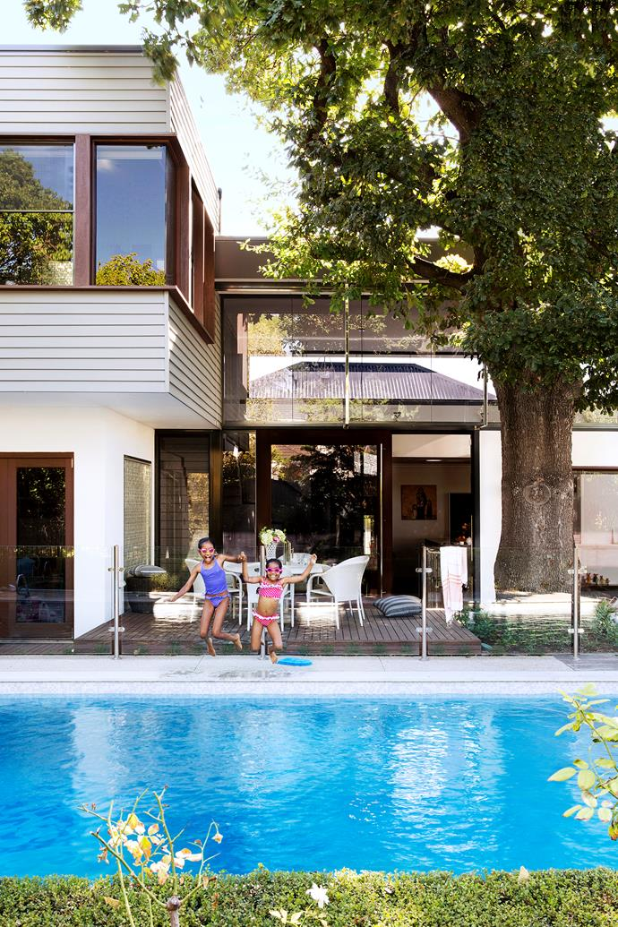 """There are plenty of features to draw the family outside: a timber deck where they dine most summer evenings, a cubbyhouse for the three daughters and a swimming pool. """"The girls love the pool!"""" says their mother."""
