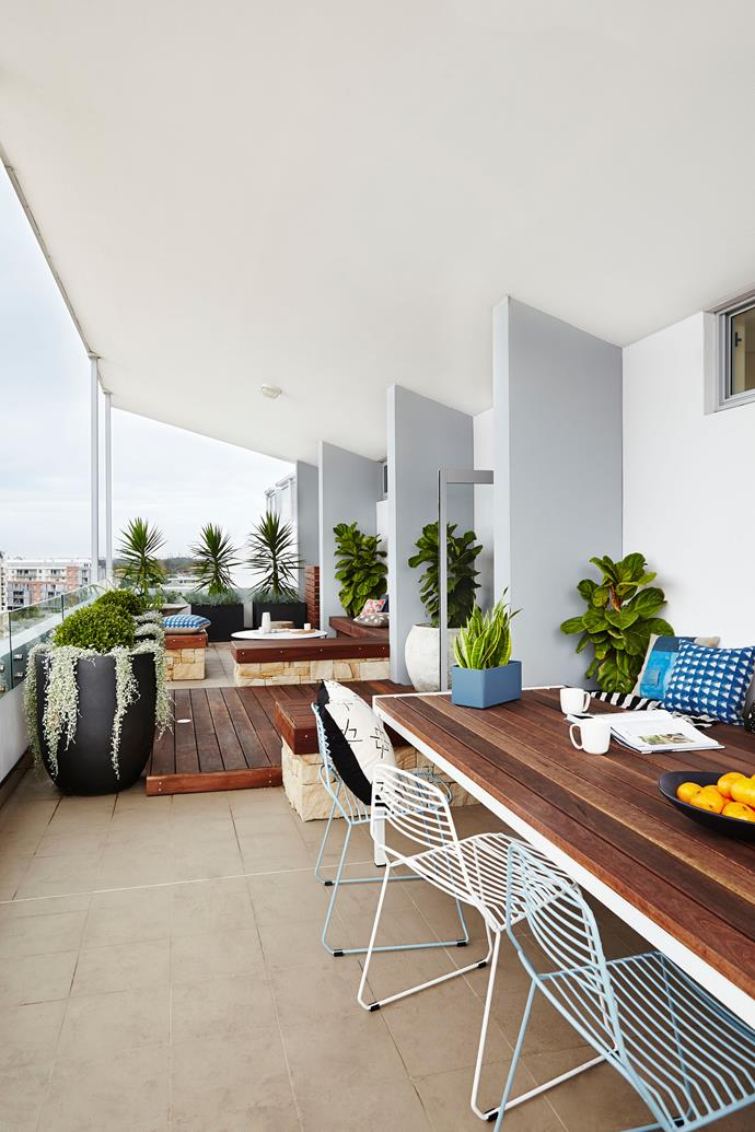 "The large wraparound balcony overlooks Randwick Racecourse, and hardy, durable plants were favoured because of the wind factor. **Table** and **chairs**, both from [Tait](http://madebytait.com.au/‎?utm_campaign=supplier/|target=""_blank"")."