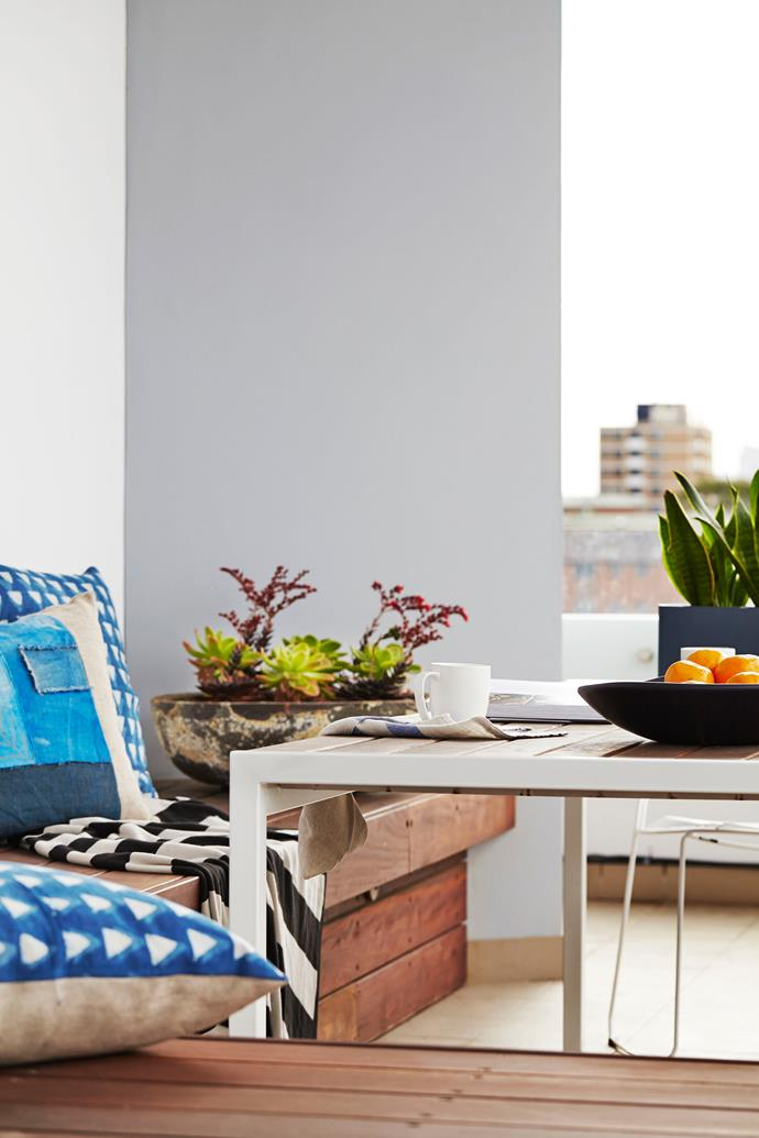 Bright cushions add pops of colour without affecting the calm energy of the space.