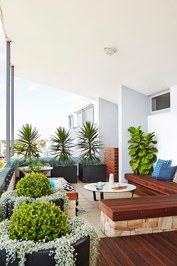 Natural materials, lush plants and a pop of colour here and there come together to create the perfect urban balcony garden.