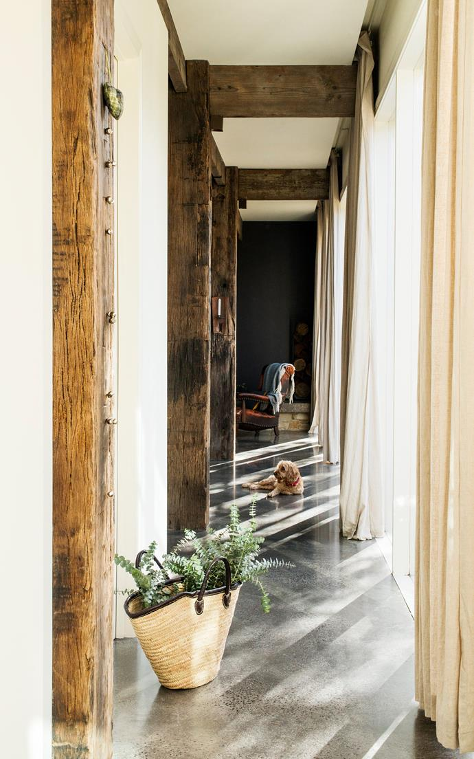 The recycled timber beams throughout the house were sourced from the historical Darling Harbour piers in Sydney. Concrete flooring and low-E glass contribute to the home's sustainability by keeping energy use to a minimum.