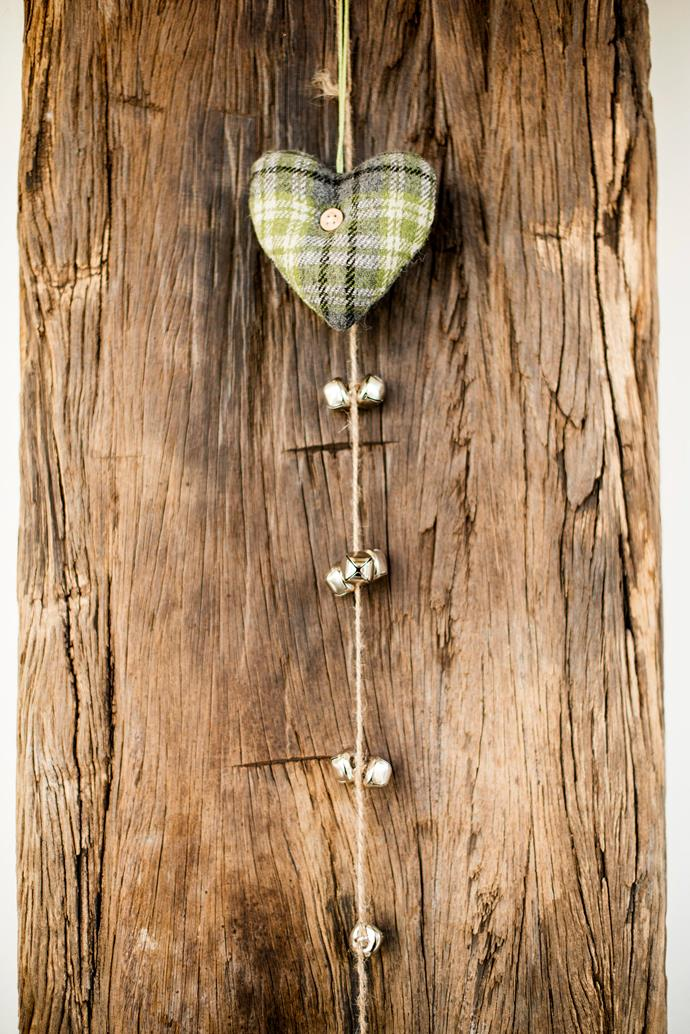 A cute plaid heart graces an interior timber post.
