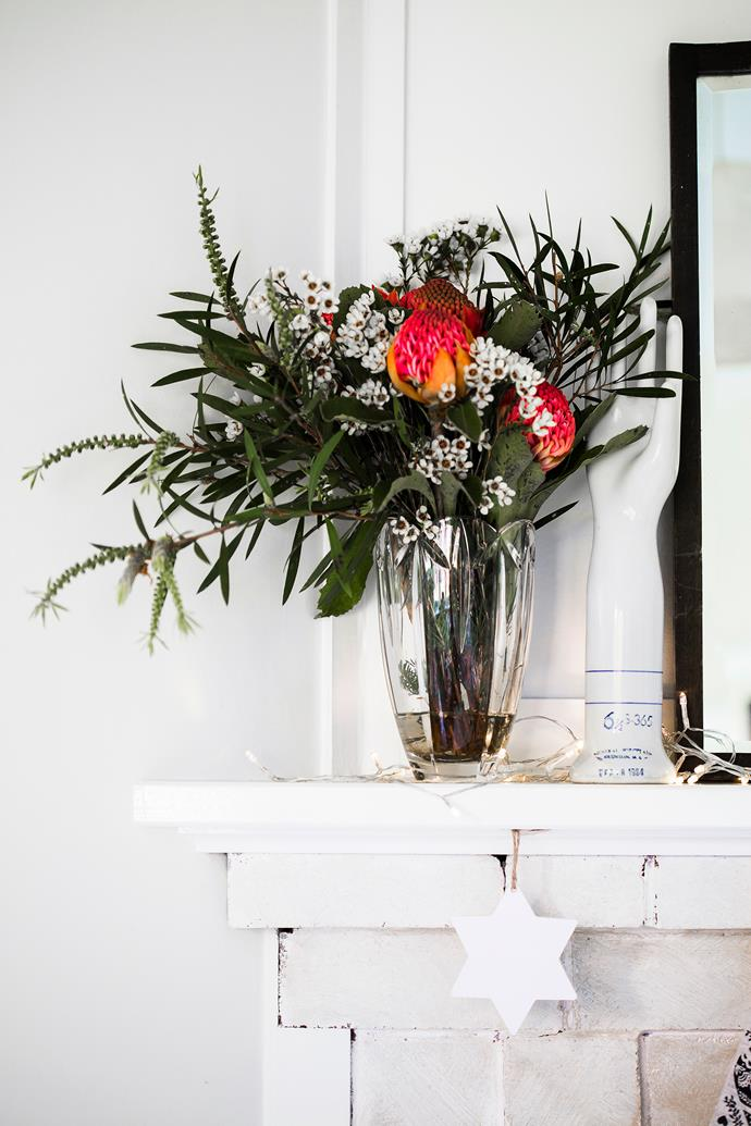 """Waratah (*Telopea speciosissima*), Geraldton wax (*Chamaelaucium uncinatum*) and native leaves combine in a cheery arrangement on the living room mantel. The glove mould is a vintage find. **Wall paint** is [Taubmans](http://www.taubmans.com.au/?utm_campaign=supplier/