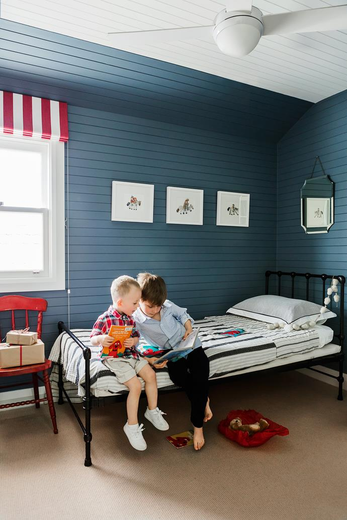 """Liam, with Jett-Levi, in his upstairs bedroom; a boy's zone made cool with striped bedlinen and blue walls. Both the antique-look bed and the chair were bought at auction. **Wall paint** is [Dulux](http://www.dulux.com.au/?utm_campaign=supplier/