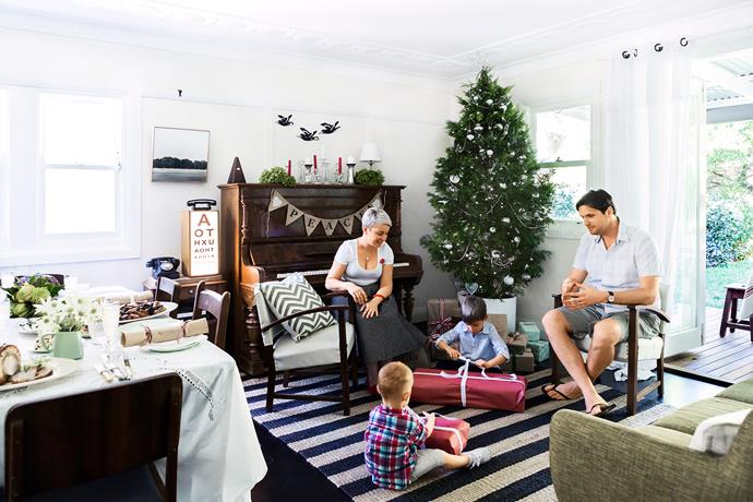 """Catherine, son Liam, husband Paul and nephew Jett-Levi (foreground) gather in the family room. A potted cypress pine is the Christmas tree of choice this year. **Tree** from [Tropical Plant Rentals](http://tropicalplantrentals.com.au/?utm_campaign=supplier/