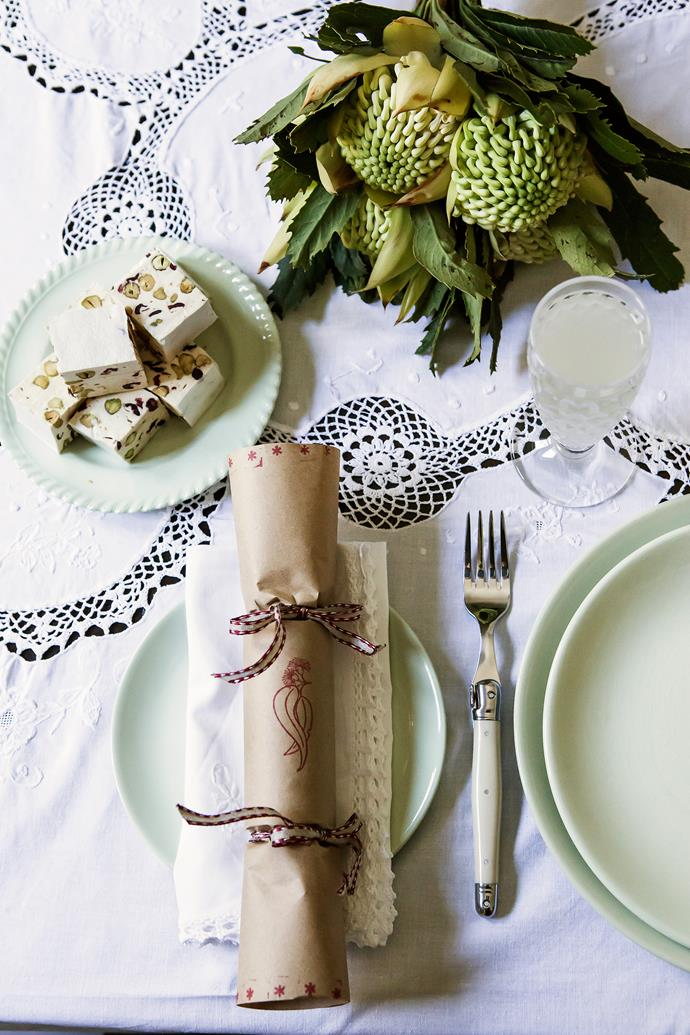 """The table is set with a blend of old and new, such as vintage plates and napkins, Laguiole cutlery, and Christmas bonbons handmade by Catherine using a [Jemac](http://www.jemacstamps.com.au/?utm_campaign=supplier/