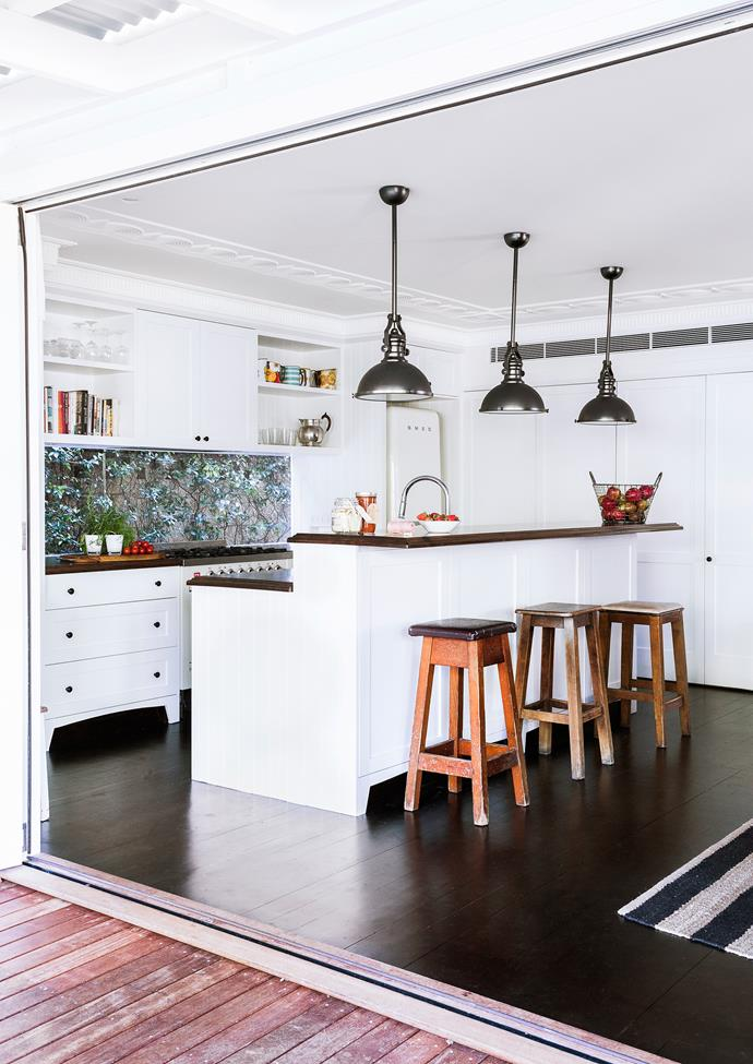"""The new, modernised kitchen has a picture window looking onto a star jasmine-covered wall at the side of the house, and benchtops made from recycled telegraph poles. Pendant **lights** from [Schots Home Emporium](https://www.schots.com.au/?utm_campaign=supplier/
