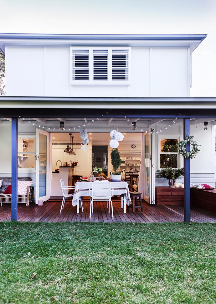 """Adjacent to the kitchen and family room, the deck – part of the rear two-storey extension by architect Wayne McPhee – is perfect for entertaining at Christmas. **Cage lights** from [Fat Shack Vintage](http://www.fatshackvintage.com.au/?utm_campaign=supplier/
